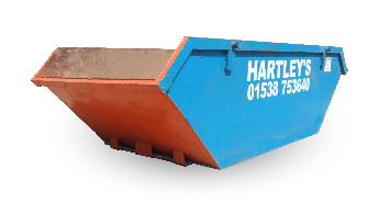 Picture of a skip with the hartleys skip hire phone number on the side 01538753640